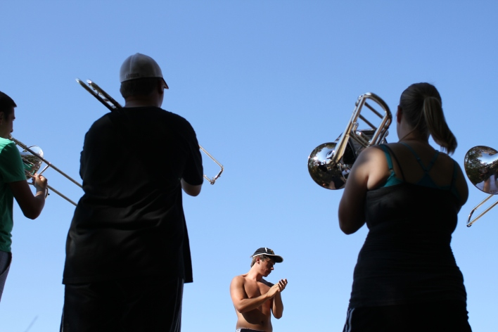 Benjamin Duddy, center, claps to keep the trombone sectional in time Aug. 30, 2012 in the parking lot behind Hearnes Center. Marching Mizzou practices often include sectional practice before the entire band practices together.