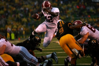 Alabama running back Eddie Lacy jumps through a gap of players for a touchdown Saturday, Oct. 13, 2012 at Memorial Stadium. Alabama defeated Mizzou 42-10.