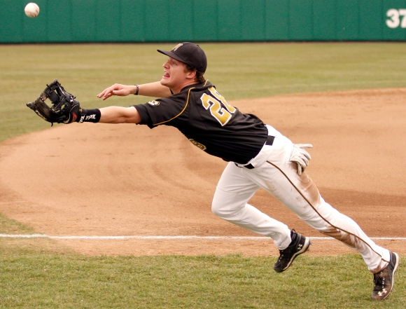 Mizzou third baseman Conner Mach dives for a foul ball against Central Michigan on Saturday, March 19, 2011. Mizzou won 14-7.