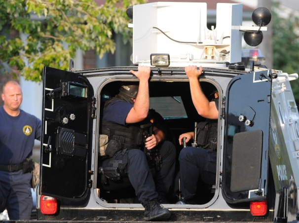 Members of the Columbia Police Department SWAT team arrive in a vehicle called the peacemaker Monday, Sept. 24, 2012 on Bonny Linn Drive. Columbia Police surrounded the house for over eight hours over a tip of a potential shooting suspect inside the house. The house was empty.